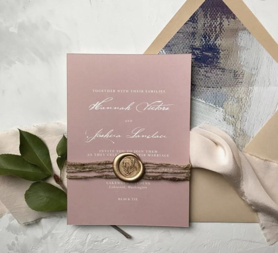 laksegl på bryllupsinvitation